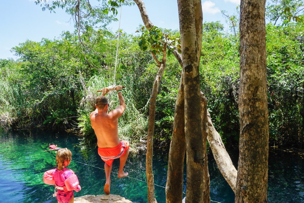 jumping in at Cenote Escondido