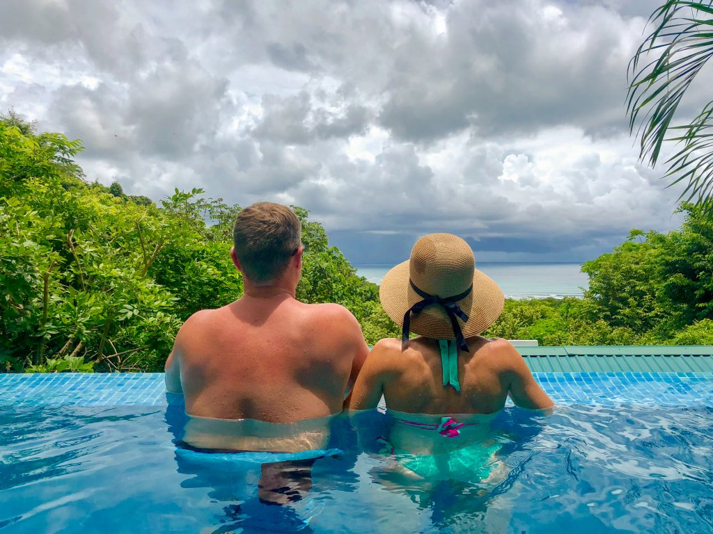 looking out at views of the jungle and ocean from our private plunge pool