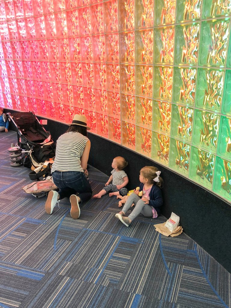 diaper changes and playtime during a layover -flying with a toddler and baby