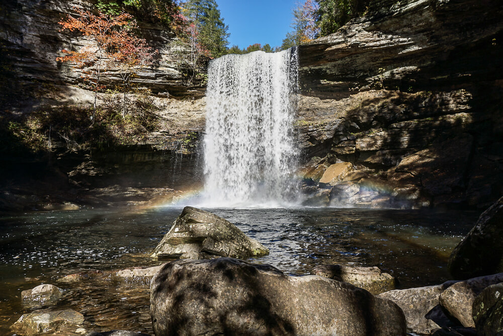 fall foliage surrounding Greeter Falls waterfall outside of Nashville