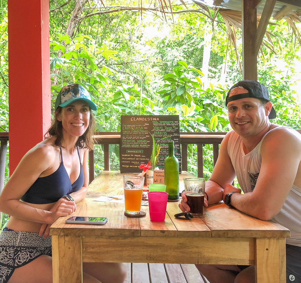 couple sitting at table in jungle restaurant
