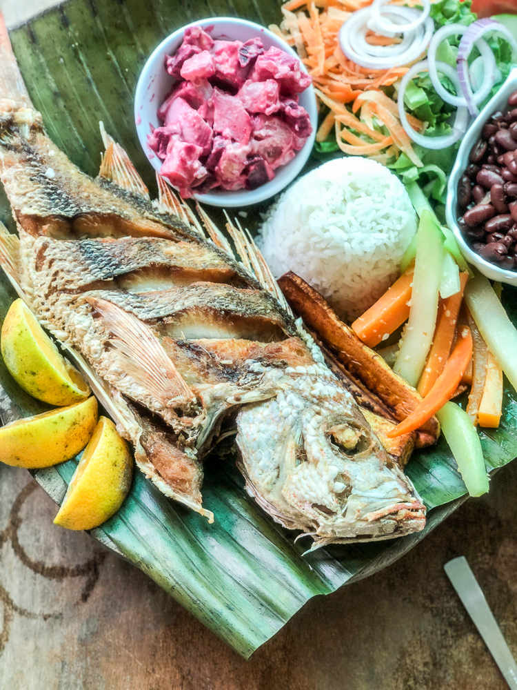 whole fried fish with vegetables and rice
