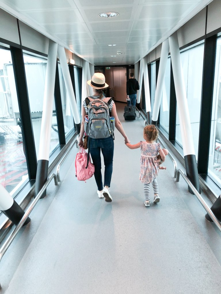 boarding a flight to Rome with kids
