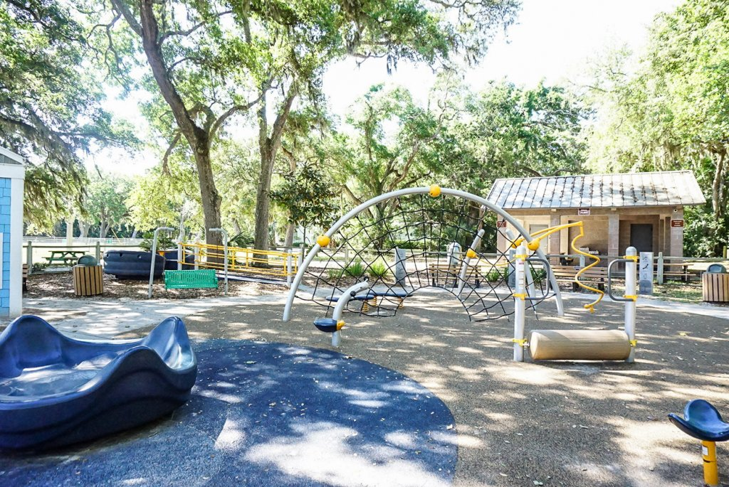 multiple play areas, climbing structures, and merry go round at pirate park on Amelia Island great with kids