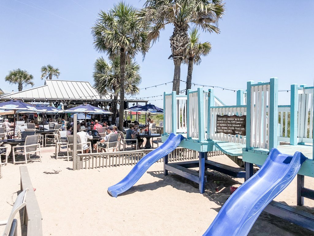 playground in the sand at Sliders Seaside Grill on Amelia Island that is perfect for toddlers and kids