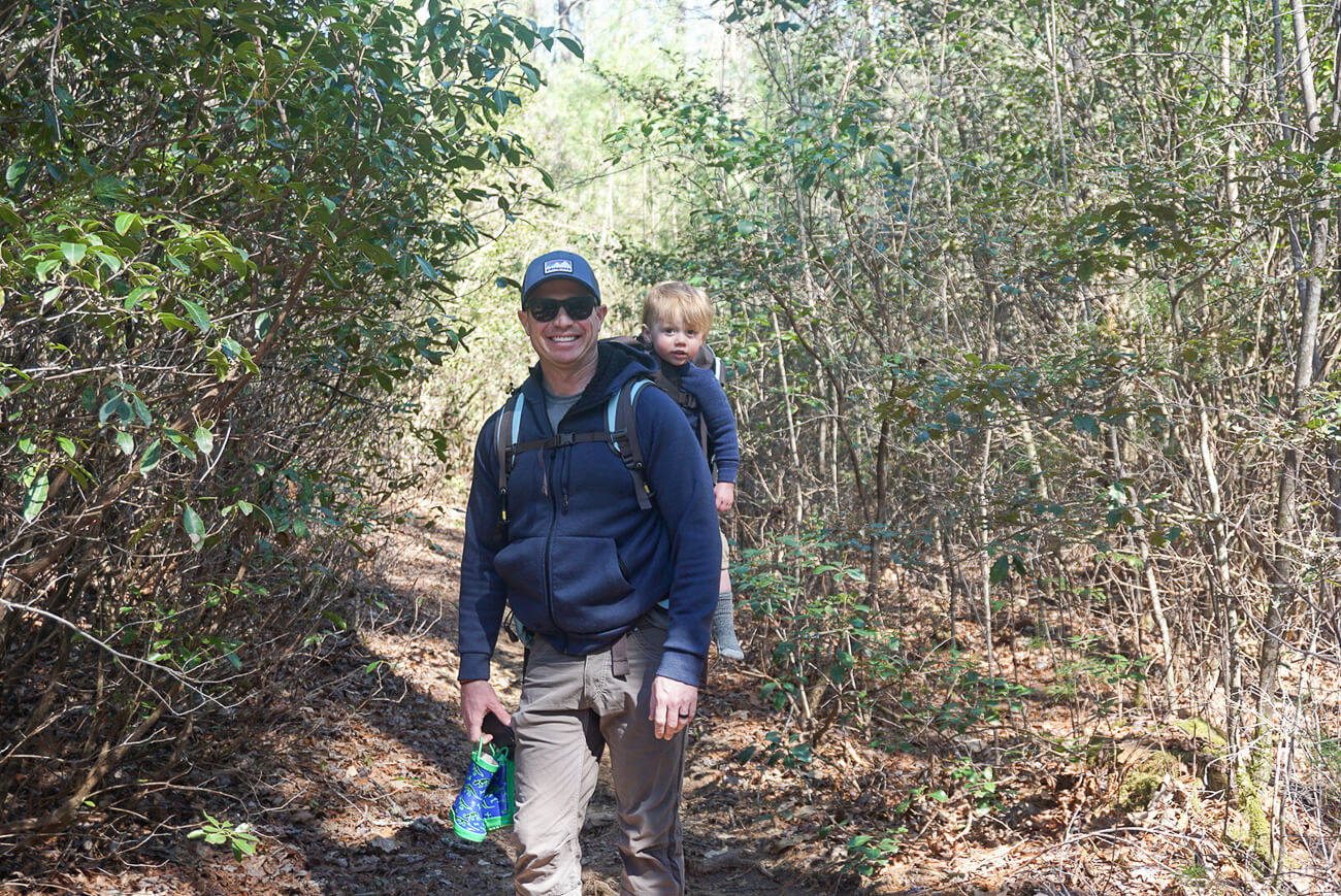 dad and son on trail to Secret Falls near Highlands, NC