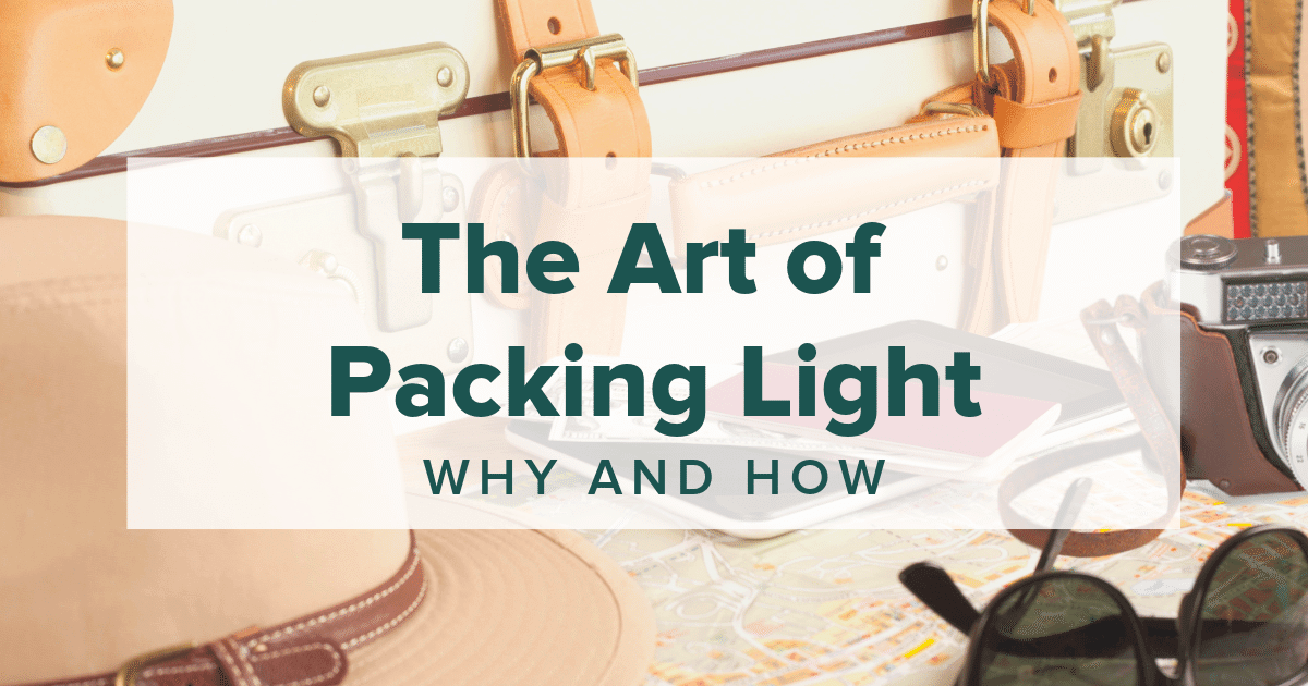 "picture of suitcase with script ""the art of packing light"""
