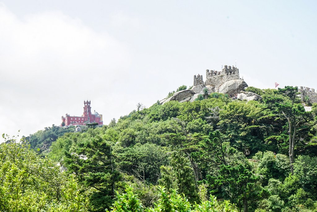 view of the Pena Palace and Moorish Castle on the hilltop in Sintra