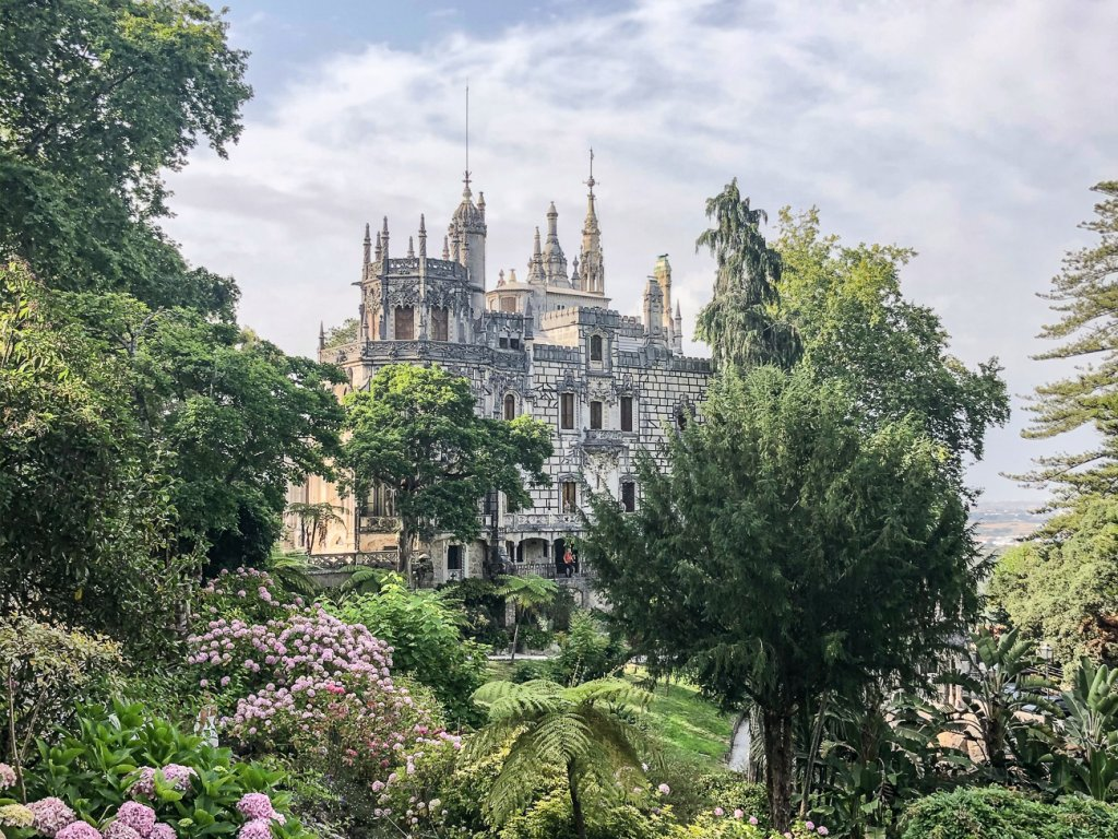 view of the Quinta da Regaleira in Sintra surrounded by the gardens
