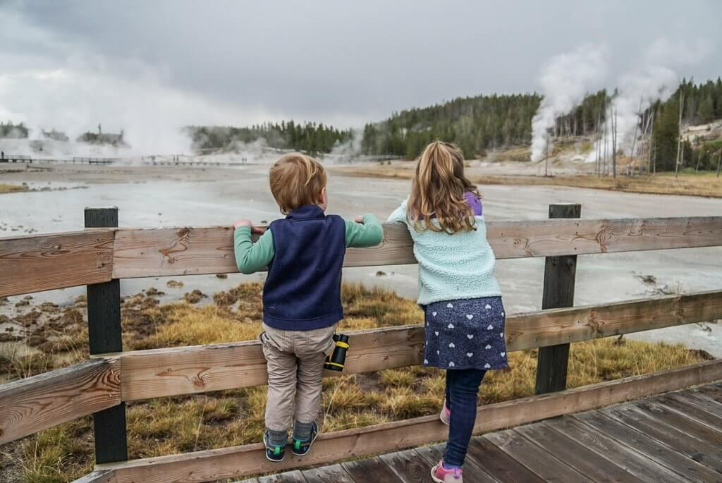 kids checking out the hot springs and geysers of the the Norris Geyser Basin
