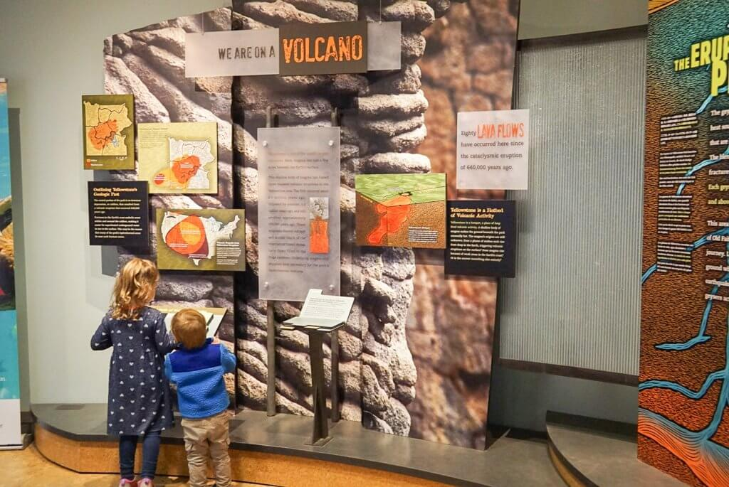kids learning about volcanoes at interactive exhibits in Yellowstone