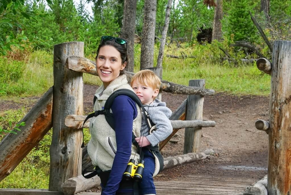 hiking to Wraith Falls in Yellowstone with kid in a backpack