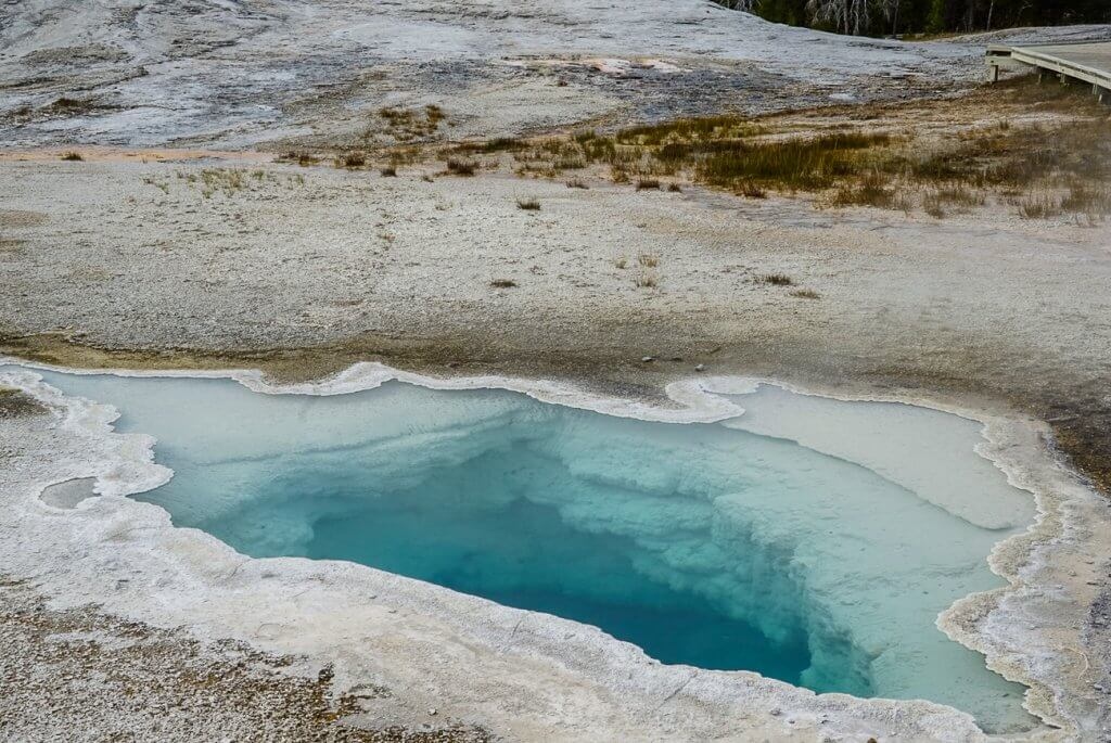 a hot spring with crystal clear water in Yellowstone
