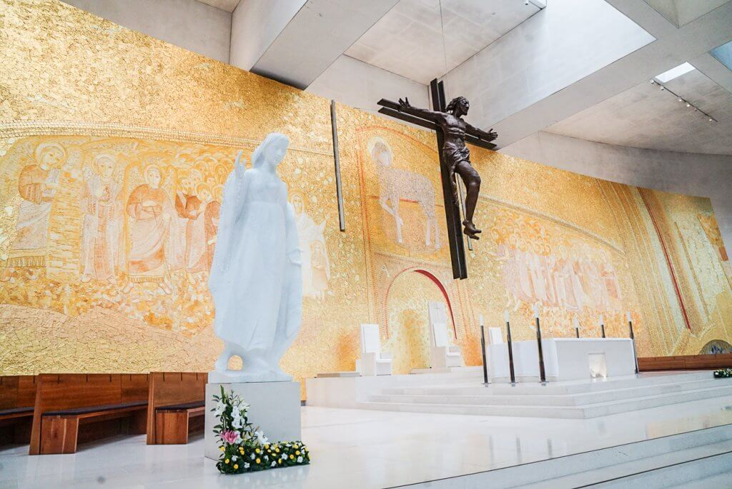 golden wall with Mary in foreground inside the Basilica of Holy Trinity in Fatima