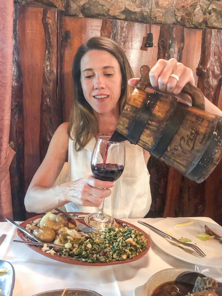 pouring wine at O Crispim in Fatima
