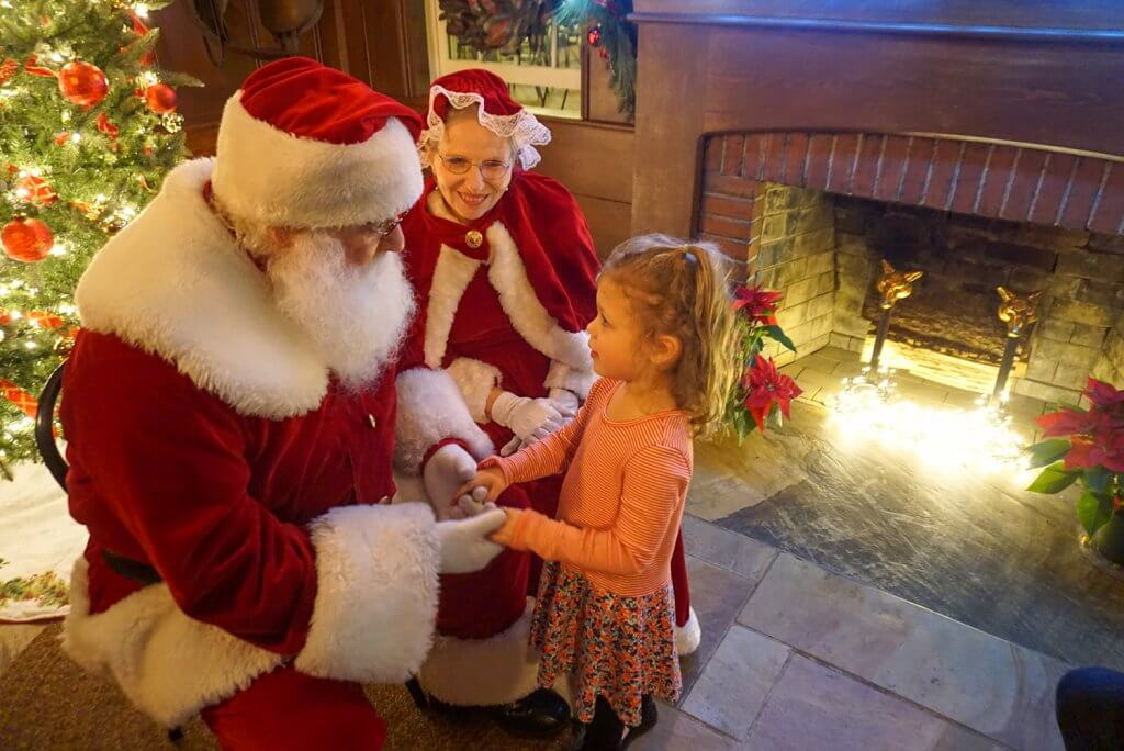 little girl meeting with Santa at Cheekwood