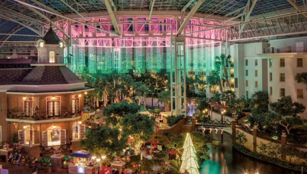 atrium of the Gaylord Opryland Hotel lit up and decorated for Christmas