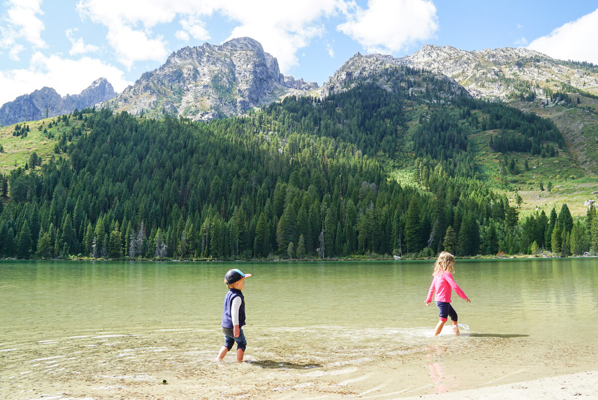 splashing around in Leigh Lake in Grand Teton national park