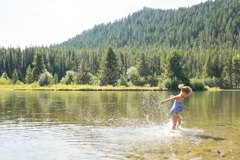 playing in the cold water at Oxbow Bend in Grand Teton National Park